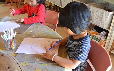 girl drawing at childcare