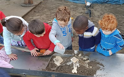 children playing with sand and water at preschool