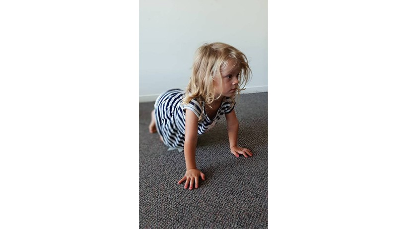 children doing yoga at Lollipops Kumeu childcare