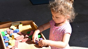 girl at daycare spontaneously playing